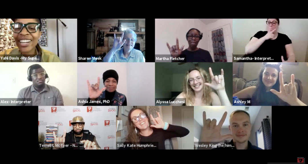 The image is a screenshot of nine participants in a Zoom meeting on providing communal care for deaf people. Five of them are making the American Sign Language sign for the phrase 'I love you.'